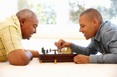 Men playing chess. Brain enhancing games help to prevent symptoms of alzheimer's disease.